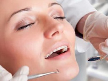Woman's relaxed faced with her eyes close while in a dental chair; for information on sedation dentistry